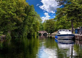 Cruiser on the river Wensum, Norwich, Norfolk